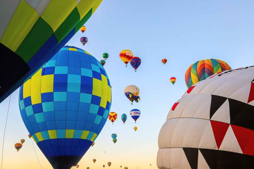 low angle shot of airborne multi colored hot air balloons